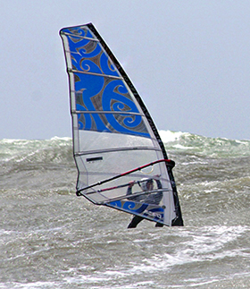 Aircelle's Emmanuel Drouet rides the waves during a windsurfing outing.